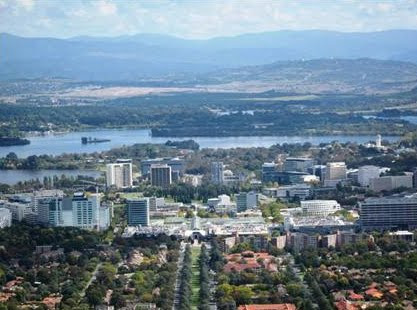 The city centre, the Western lake and the Brindabella mountains beyond