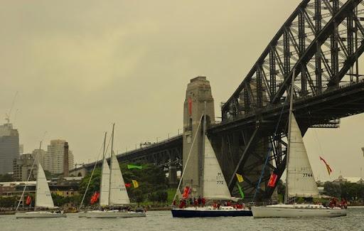 Synchronized yachting against the Harbour Bridge. Celebrating Australia Day in Sydney Harbour