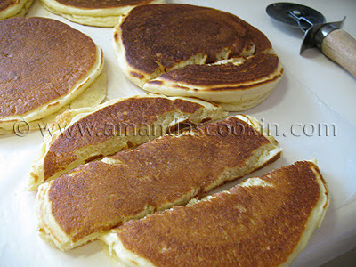 A photo of sliced pancakes on a cutting board.