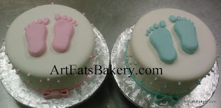 Girl's and boy's custom creative pink and blue fondant footprints baby shower cake designs with edible pearls and bows