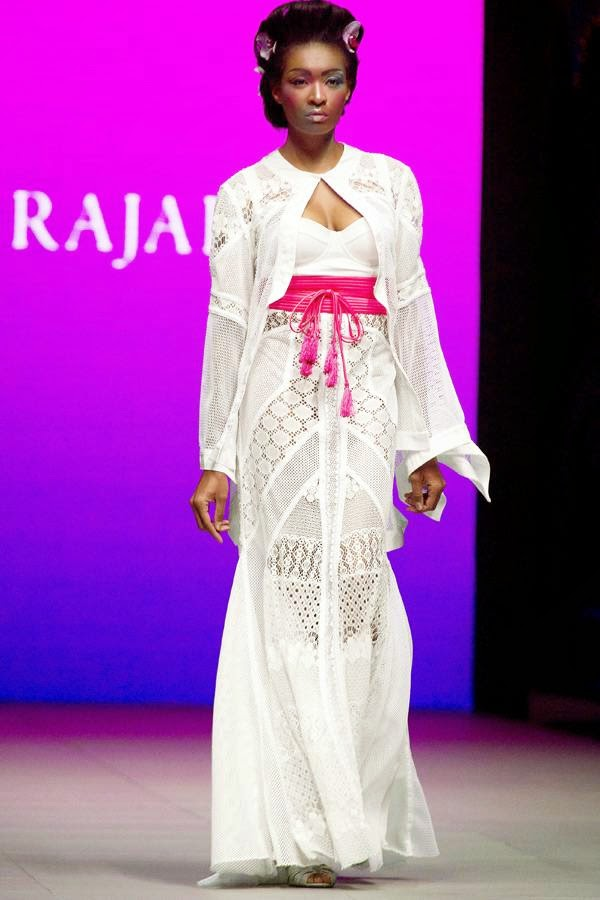 A model presents a creation by South African fashion designer Gavin Rajah on July 24, 2014 during the fashion week at the Cape Town International Convention Centre, in Cape Town, South Africa.
