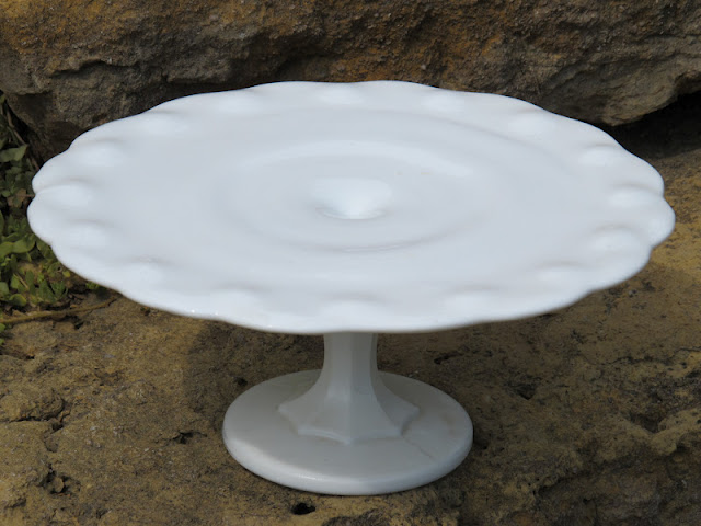 Milk Glass Teardrop Cake Stand from the rental inventory of www.momentarilyyours.com