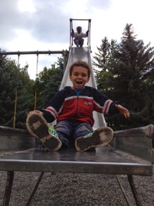 Bean coming down a slide at top speed