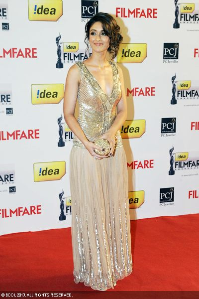 B&#039;wood&#039;s &#039;south import&#039; Ileana D&#039;cruza looks elegant in beige and gold Cavalli outfit as she walks the red carpet at the 58th Idea Filmfare Awards 2013, held at Yash Raj Films Studios in Mumbai.Click here for:<br />  58th Idea Filmfare Awards