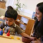LePort School Parent/Child Montessori  - mommy guiding her child