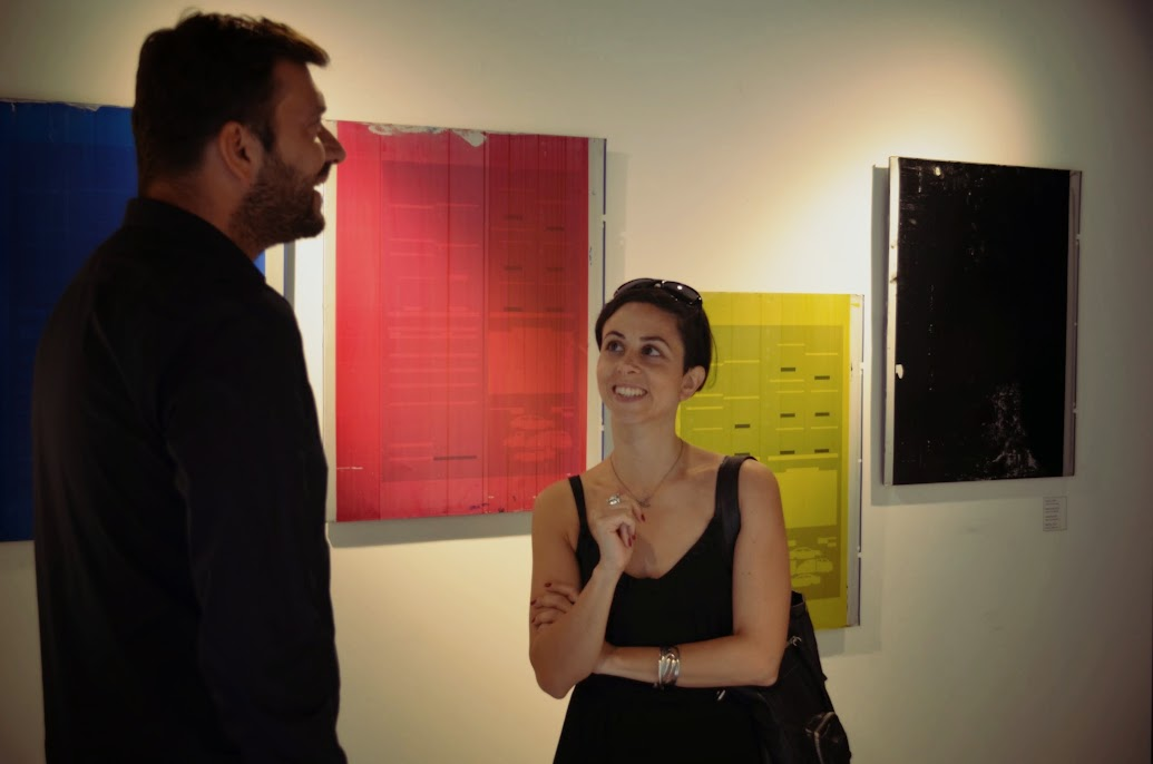 Bora Ozbek talking to art walk tour guide Seza Bali