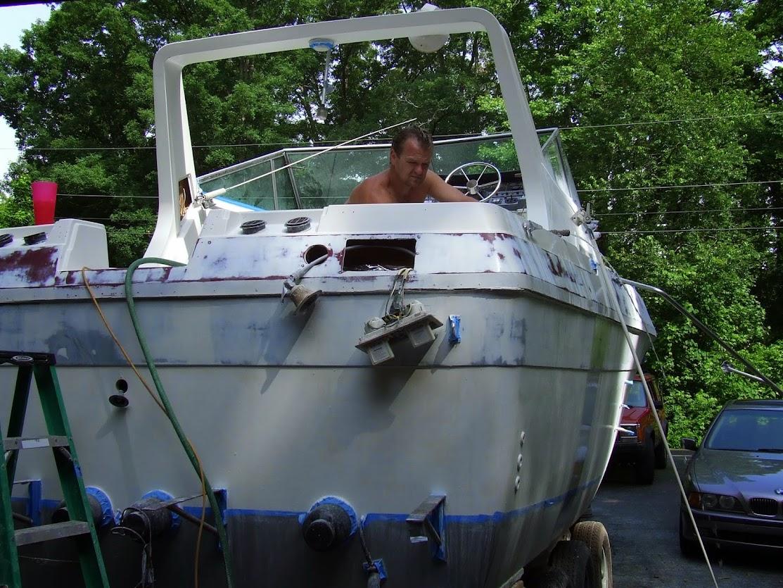 Tim Griffin restoring a boat