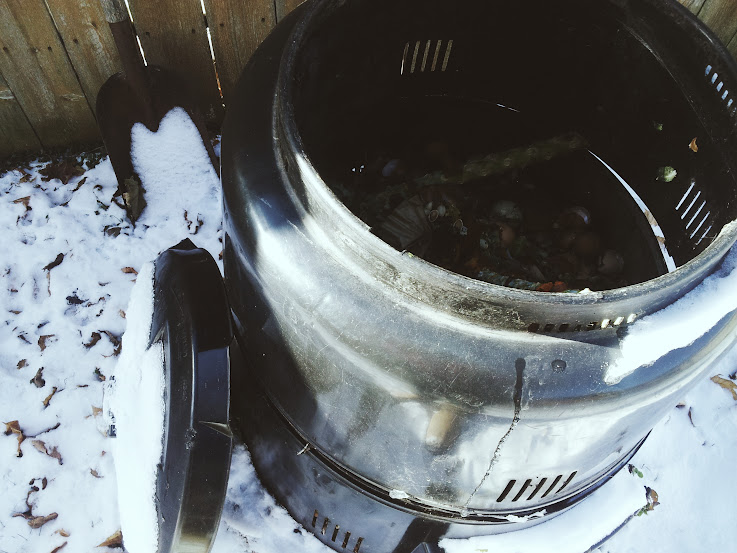 winterize your compost pile with a lid or cover