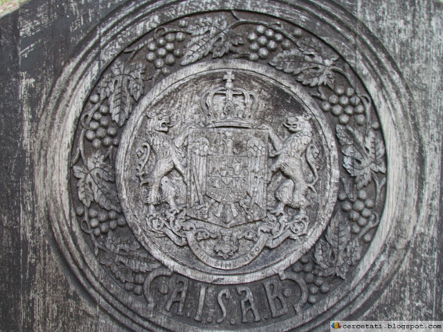 Kingdom of Romania coat of arms carved on a barrel