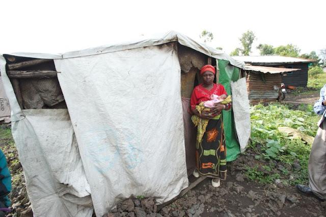 woman and baby at shanty