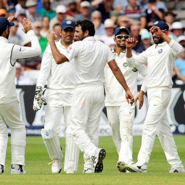 India's Mohammed Shami, center, celebrates after bowling and caught England's Moeen Ali for 14 runs during day three of the first Test between England and India at Trent Bridge cricket ground, Nottingham, England, Friday July 11, 2014.