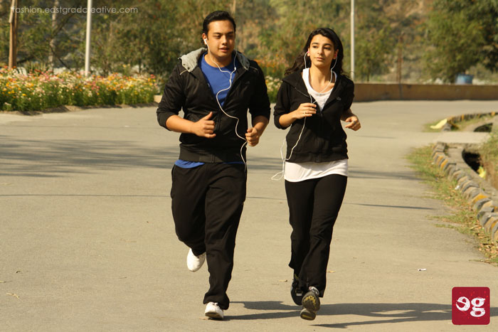 Track suit, t-shirt, ear phones and sports shoe for smooth and comfortable jogging.