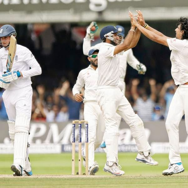 India's Ishant Sharma, right, celebrates with his teammates after taking the wicket of England's Stuart Broad, left, during the test match on the fifth day of the second cricket test match between England and India at Lord's cricket ground in London, Monday, July 21, 2014. India won the match by 95 runs.