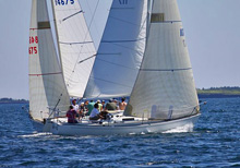J/29s crossing tacks sailing upwind