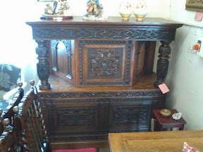 Big old intricately carved furniture piece