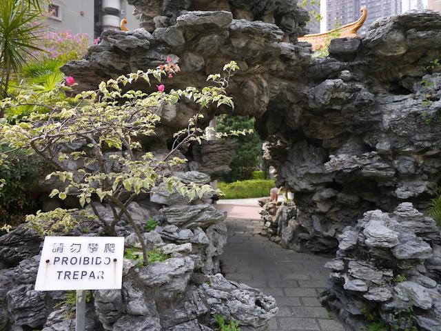 tunnel through an artificial rock formation in a Macau park