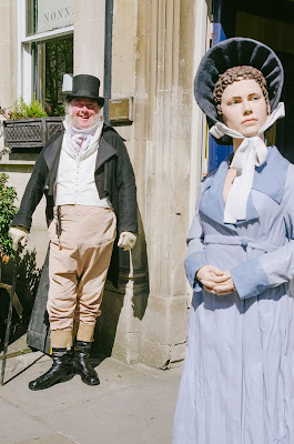 Slightly creepy doll and man in period gear outside the Jane Austen centre