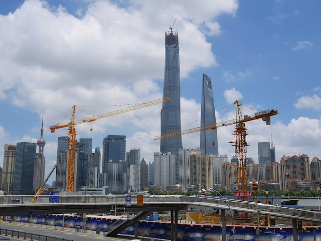 View of Shanghai's Lujiazui area from a pedestrian bridge across the Huangpu River
