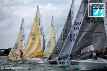 J/24 one-design sailboats- sailing at start