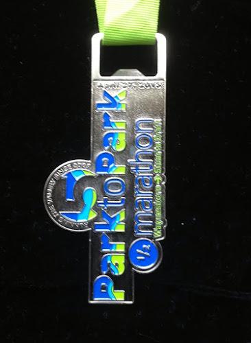2013 Park to Park Half Marathon medal