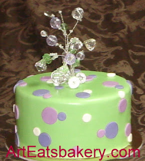 Modern green and purple girl's night out cake with fondant polka dots and crystal topper