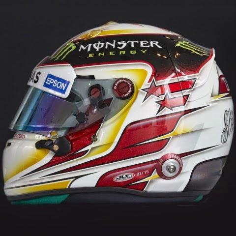 Per Lewis Hamilton sfondo bianco con alcuni motivi gialli e rossi. Molto diverso dai caschi delle origini e forse meno riconoscibile