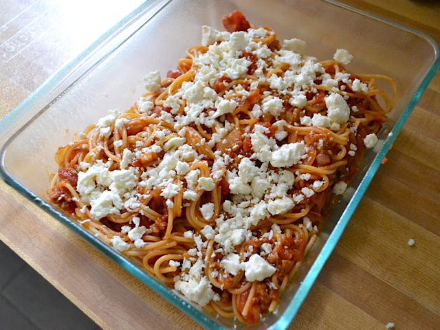 add a layer of spaghetti to baking dish topped with cheese