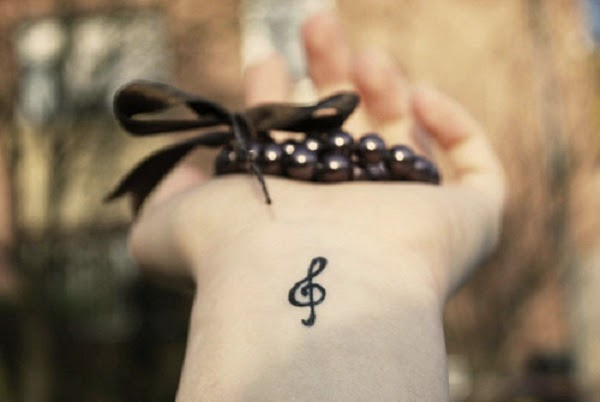 small music symbol & tattoo on wrist