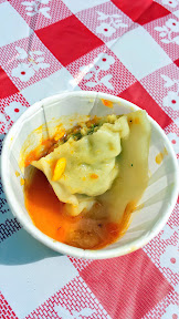 Eat Mobile 2014 - bite from Momo Cart, nice intensity of flavor from the half of a chicken dumpling sample from Momo Cart, the dumpling is stuffed with chicken, garlic, onion, and Nepali spices