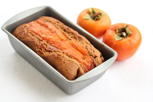 overhead photo of persimmon bread in a pan