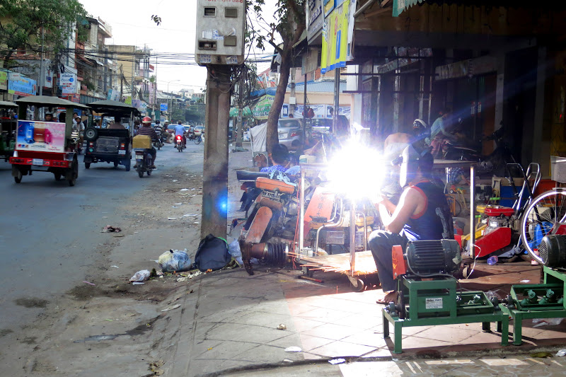 Welding on the sidewalk