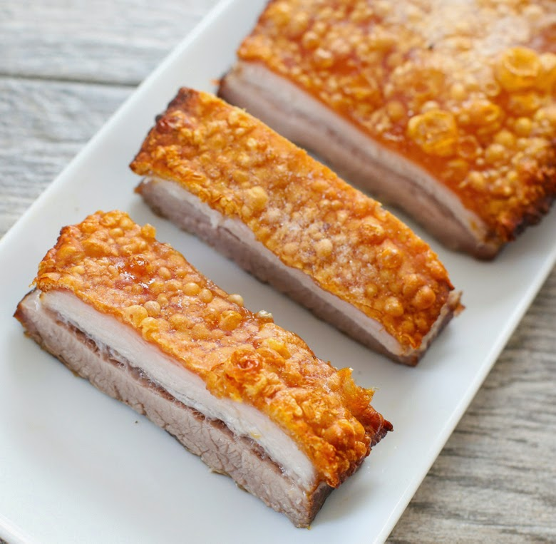 close-up photo of two slices of the crispy pork belly