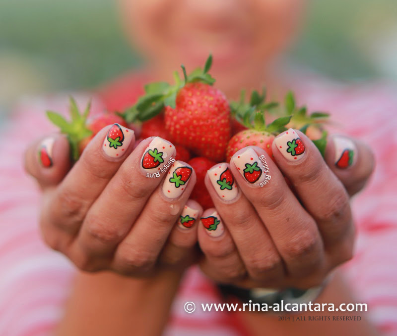 Simply Rins Holding Strawberries