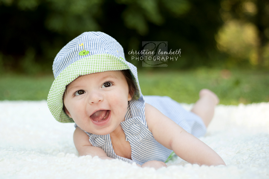 Adorable 4 month old boy in gingham hat