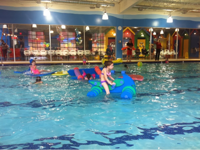 Kids swimming with floats at Birthday Party