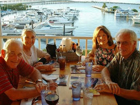 Dave and Marcella on the left and Joanie and Mike on the right and the boat I want behind them