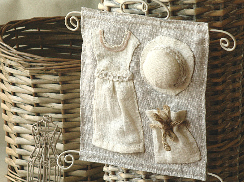 Sewing room wall decoration with pincushion hat, dress and bag pocket