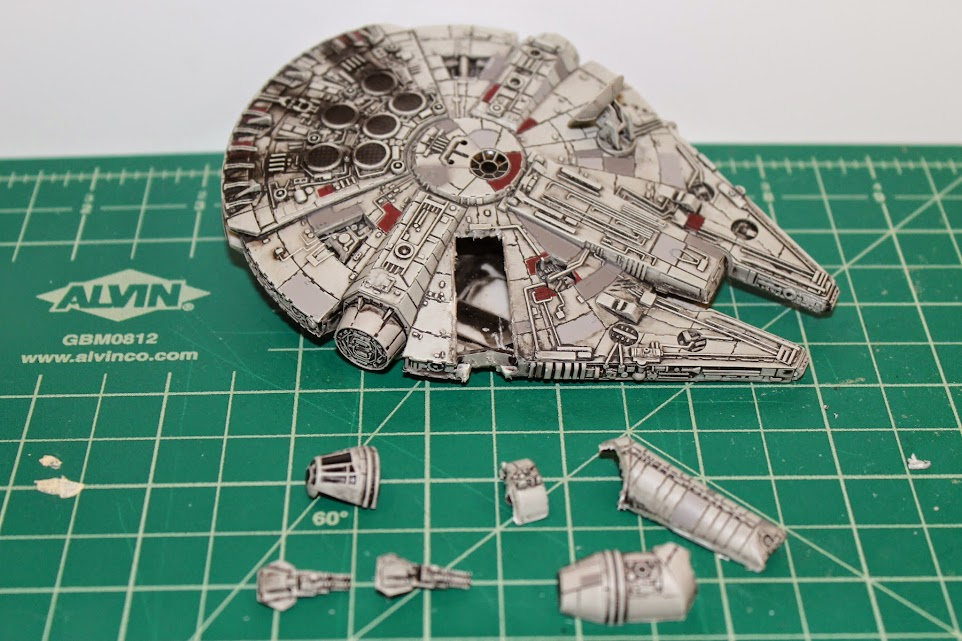 Photo of Millennium Falcon model with hole cut in it.