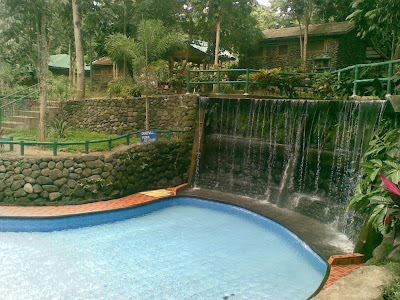 Tiled pool with man-made waterfalls