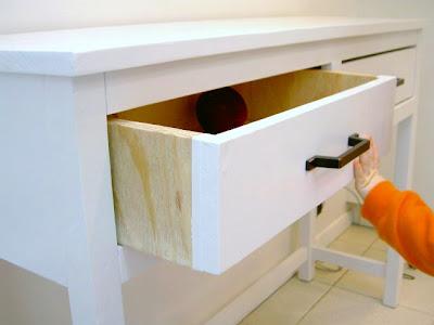 sideboard drawer with dark hardware