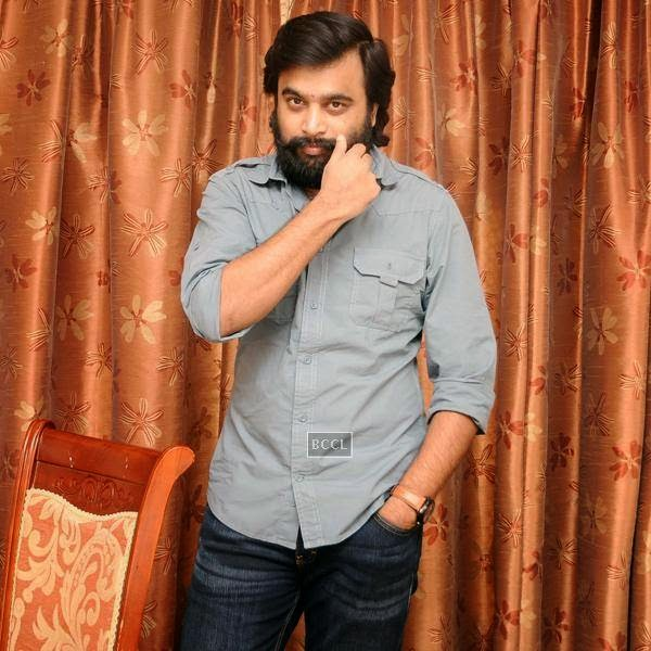 M Sasikumar poses for the cameras during the movie pooja of Thaarai Thappattai, held in Chennai.