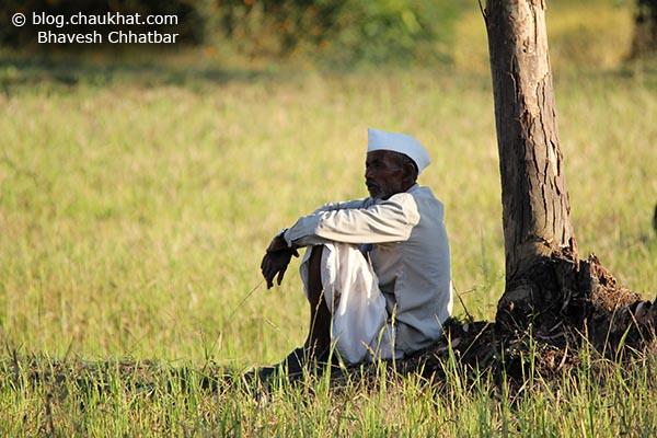 Poor yet happy Indian farmer