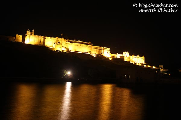 Amber Fort at night [also called Amer Fort] with reflection in water