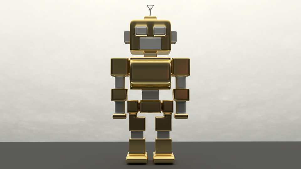 A gold robot standing in front of a white wall.