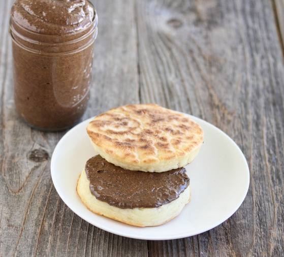 photo of an english muffin on a plate with cookie butter