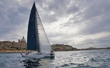 J/122 Artie sailing to finish line in Malta's harbor