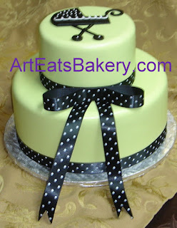 Custom designed green fondant babby shower cake with stroller and black and white polka dot ribbon picture