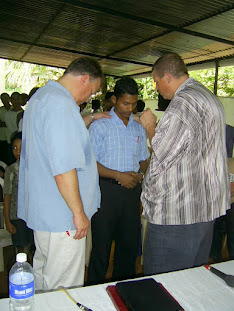 Tom and I praying with a pastor in Amellepolly