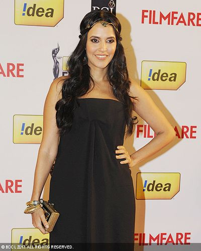 Neha Dhupia is all smiles as she poses for the cameras during the 58th Idea Filmfare Awards 2013, held at Yash Raj Films Studios in Mumbai.Click here for:<br />  58th Idea Filmfare Awards<br />