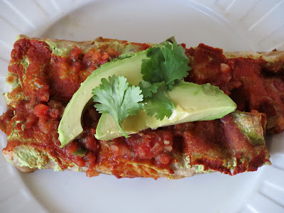 Tempeh and black bean enchiladas with tofu cheese and red sauce